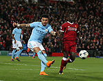 Kyle Walker of Manchester City clears under pressure from Sadio Mane of Liverpool during the Champions League Quarter Final 1st Leg, match at Anfield Stadium, Liverpool. Picture date: 4th April 2018. Picture credit should read: Simon Bellis/Sportimage