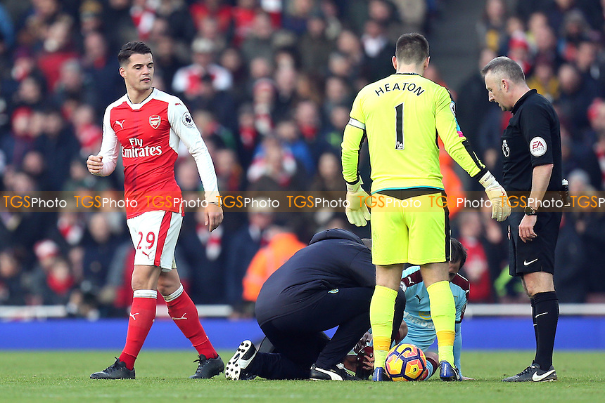 Granit Xhaka of Arsenal leaves the pitch after being shown a red card by referee Jonathan Moss  or a reckless challenge on Steven Defour during Arsenal vs Burnley, Premier League Football at the Emirates Stadium on 22nd January 2017