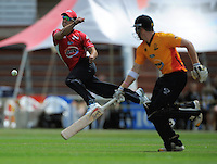 Canterbury's Ryan Tendoschate tries to run out Stuart Rhodes. HRV Cup Twenty20 cricket - Wellington Firebirds v Canterbury Wizards at Allied Nationwide Finance Basin Reserve, Wellington. Sunday, 5 December 2010. Photo: Dave Lintott / lintottphoto.co.nz