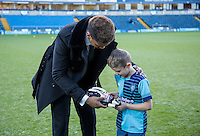 A young mascot receives a pair of gloves from Goalkeeper Jamal Blackman of Wycombe Wanderers during the Sky Bet League 2 match between Wycombe Wanderers and Newport County at Adams Park, High Wycombe, England on 2 January 2017. Photo by Kevin Prescod.