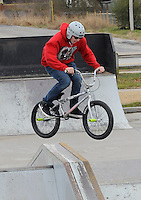 NWA Media/FLIP PUTTHOFF <br /> TWO-WHEEL TRICKS <br /> Johnny Mills of Avoca does a jump on his bike Tuesday Dec. 23 2014 at the Rogers skate park at North Second and Olive streets, adjacent to the Rogers Activity Center. The park was popular with stunt bikers and skateboarders on Tuesday with Christmas break underway at area schools.