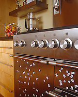 Mathematical magnets cover the doors of this stainless steel oven
