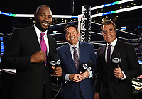 "BROOKLYN - JANUARY 26: Fox Sports boxing  commentators Lennox Lewis, Chris Myers, and Joe Goossen on the ""FOX PBC Fight Night: Thurman vs. Lopez"" at Barclays Arena on January 26, 2019, in Brooklyn, New York. (Photo by Frank Micelotta/Fox Sports/PictureGroup)"