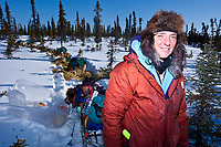 Iditarod Rookie Michelle Phillips at the Cripple checkpoint 1/2 way into the race during the 2010 Iditarod