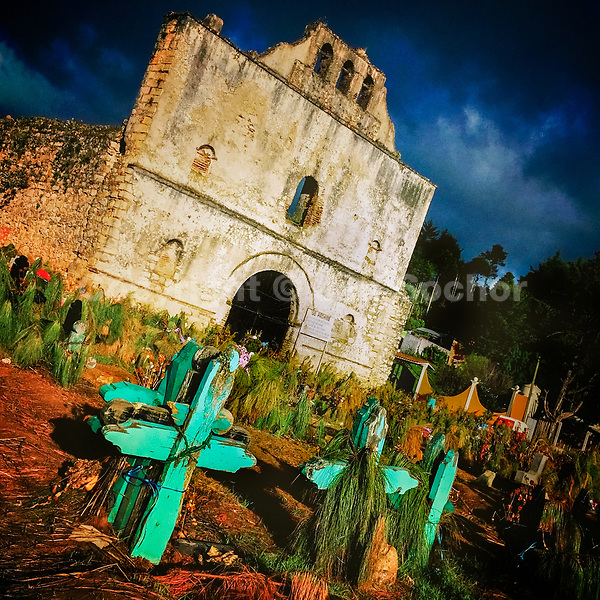 A Maya indigenous cemetery is seen in front of a ruined church of San Sebastian during the sunset in San Juan Chamula, Chiapas, Mexico, 20 November 2018.