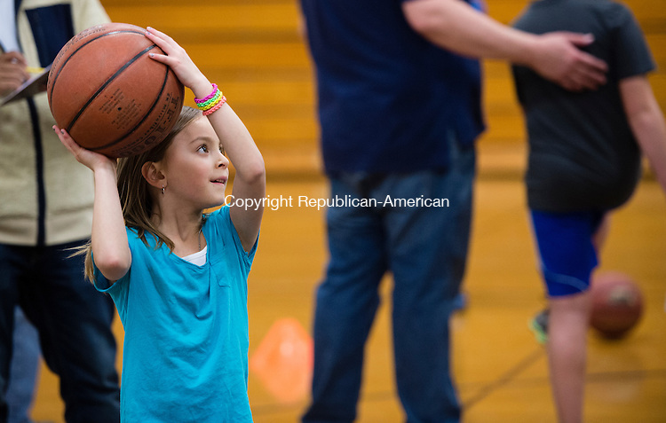 "WOODBURY, CT - 20 November 2015-112015EC18--  Gianna Geraci, 7, tries to sink a free-throw to win Thanksgiving dinner during a ""Turkey Shoot"" at Woodbury Middle School Friday night. Depending on how many baskets they made, contestants brought home turkey, pies, stuffing and cranberry sauce. Erin Covey Republican-American."