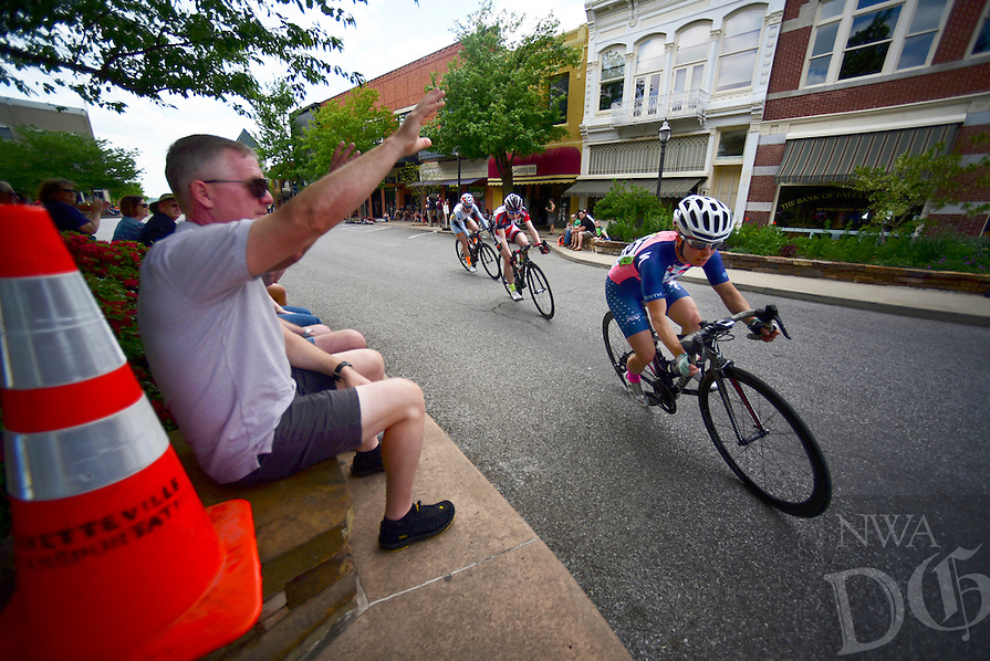 NWA Democrat Gazette/SPENCER TIREY Jerry Schmalz cheers on riders in the women's pro category in down town Fayetteville, Sunday, April 24, 2016, during the criterium stage of the Joe Martin Stage Race. Lauren Stephens with Team Tobco-Silicon Valley Bank won the stage race.