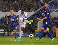 Pictured: Leroy Fer of Swansea City shoots the ball forward past Robert Huth of Leicester City Saturday 27 August 2016<br />