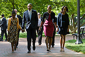 United States President Barack Obama, First Lady Michelle Obama and daughters Sasha and Malia Obama walk across Lafayette Park to attend easter services at St. John's Episcopal Church in Washington, D.C. on Sunday, April 8, 2012. They are accompanied by a detail of Secret Service agents.Credit: Kristoffer Tripplaar  / Pool via CNP