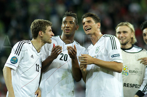 22.06.2012. Gdansk, Poland. Euro 2012 Germany versus Greece Quarter-finals PGE Arena Gdansk   THOMAS MULLER (GER)  , JEROME BOATENG (GER)  , ANDRE SCHURRLE (GER) thank their fans after their 4-2 win which took  them into the semi-finals