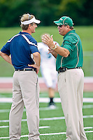 October 2, 2010:   Jacksonville Dolphins head coach Kirwin Bell (r) and San Diego Toreros head coach Ron Caragher talk on the field prior to the start of Pioneer Football League action between the San Diego Toreros and Jacksonville University Dolphins at D. B. Milne Field in Jacksonville, Florida.  Jacksonville defeated San Diego 35-28.