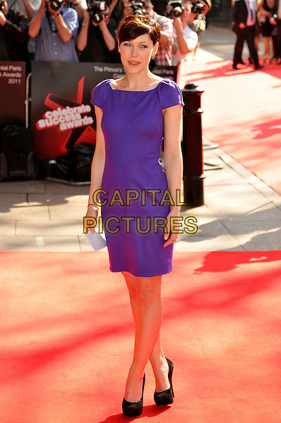 EMMA WILLIS.The Prince's Trust Celebrate Success Awards at Odeon Leicester Square, London, England..March 23rd, 2011.full length purple dress griffiths black shoes tongue.CAP/CJ.©Chris Joseph/Capital Pictures.