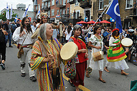 Montreal, CANADA - June 24, 2105.<br /> <br /> Thomas Mulcair, Gilles Duceppe and his wife, Pierre-Karl Peladeau and Julie Snyder, Justin Trudeau and other politicians attend the Saint-Jean-Baptiste  Quebec National Holliday parade on Saint-Denis Street in Montreal, June 24, 2015.