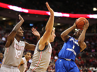 Central Connecticut State Blue Devils guard Kyle Vinales (1) goes for a basket under pressure from Ohio State Buckeyes guard Aaron Craft (4) and Ohio State Buckeyes forward Sam Thompson (12) in the second half of the college basketball game between the Ohio State Buckeyes and the Central Connecticut State Blue Devils at Value City Arena in Columbus, Saturday afternoon, December 7, 2013. The Ohio State Buckeyes defeated the Central Connecticut State Blue Devils 74 - 56. (The Columbus Dispatch / Eamon Queeney)