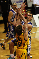 Saints forward Hugh Quinlivan is blocked by Warrick Siddall during the NBL Round 9 match between the Wellington Saints and Nelson Giants at TSB Bank Arena, Wellington, New Zealand on Thursday 7 May 2009. Photo: Dave Lintott / lintottphoto.co.nz