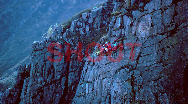 Mountain rescue team attending to a mountain climber who fell whilst climbing. The casualty came to rest on a ledge and the team absailed down to reach him. This image may only be used to portray the subject in a positive manner..©shoutpictures.com..john@shoutpictures.com