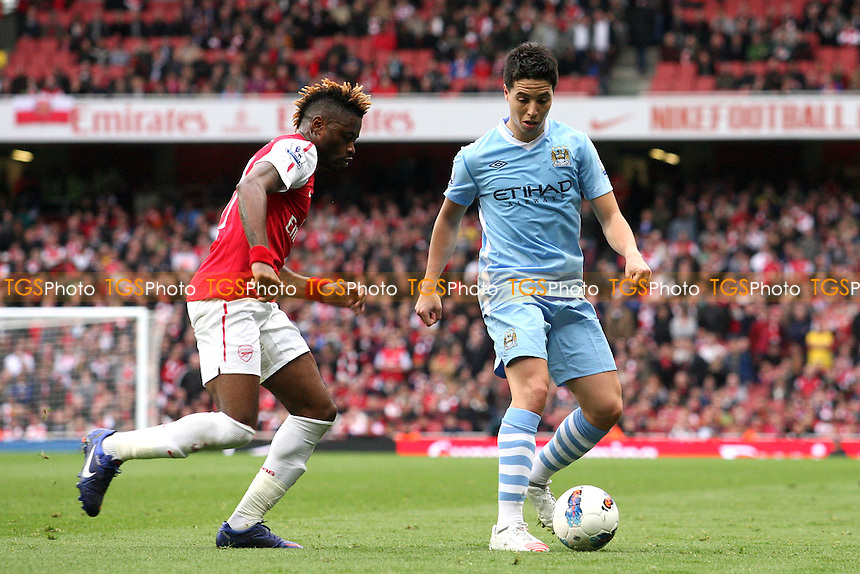 Alexandre Song of Arsenal and Samir Nasri of Manchester City -  Arsenal - Manchester City at the Emirates Stadium - 08/04/12 - MANDATORY CREDIT: Dave Simpson/TGSPHOTO - Self billing applies where appropriate - 0845 094 6026 - contact@tgsphoto.co.uk - NO UNPAID USE.