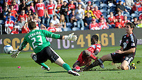 DC United defender Dejan Jakovic (5) watches Chicago Fire forward Patrick Nyarko's (14) shot go wide of DC United goalkeeper Troy Perkins (23).  The Chicago Fire tied DC United 0-0 at Toyota Park in Bridgeview, IL on Oct. 16, 2010.