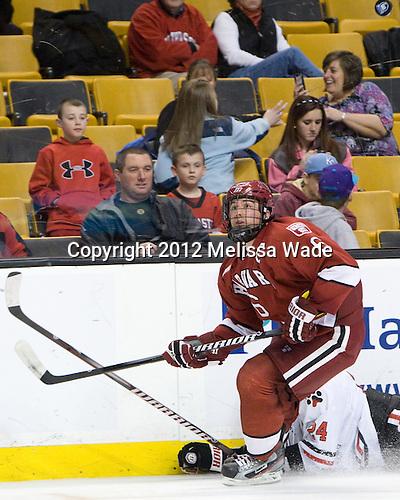 Ryan Grimshaw (Harvard - 6) - The Harvard University Crimson defeated the Northeastern University Huskies 3-2 in the 2012 Beanpot consolation game on Monday, February 13, 2012, at TD Garden in Boston, Massachusetts.