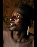 Otyiang Lonyangaluk sits with elders discussing insecurty issues in a village near Moroto, November 18, 2003. THe Karamojong tribe of Northeastern Uganda is plagued by security problems relating to young warrior/shepherds who spend idle time raiding cars and cattle of other clans and tribes making movement and development difficult. (Rick D'Elia)