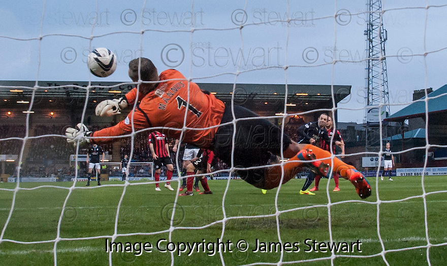 St Johnstone keeper Alan Mannus saves from Dundee's Gary Harkins.