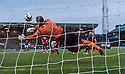 St Johnstone keeper Alan Mannus saves from Dundee's Gary Harkins.