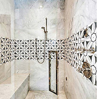 This custom shower features Edie, a handmade mosaic shown in Nero, Bardiglio, Thassos and Carrara, is part of the Silk Road Collection by Sara Baldwin for New Ravenna.<br /> -photo courtesy of Fantasia, Bozeman Montana<br /> <br /> For pricing samples and design help, click here: http://www.newravenna.com/showrooms/