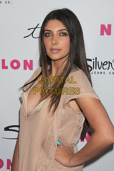 BRITTNY GASTINEAU.NYLON Magazine's 12th Anniversary Issue Party With The Cast of Sucker Punch at Tru Hollywood in Hollywood, California, USA..March 24th, 2011.half length hand on hip beige grey gray turquoise ring.CAP/ROT/TM.©Tony Michaels/Roth Stock/Capital Pictures