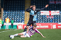 Harry Taylor of Barnet tackles Jason McCarthy of Wycombe Wanderers during the Sky Bet League 2 match between Wycombe Wanderers and Barnet at Adams Park, High Wycombe, England on 16 April 2016. Photo by Andy Rowland.