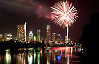 4th of July Fireworks fill the night skyline over Downtown Austin, Texas