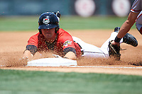 Erie Seawolves catcher Grayson Greiner (51) slides into third after hitting a triple during a game against the Altoona Curve on July 10, 2016 at Jerry Uht Park in Erie, Pennsylvania.  Altoona defeated Erie 7-3.  (Mike Janes/Four Seam Images)
