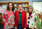 SOUTHBURY,  CT-122316JS03-Heather Messina, Mike Murphy and Kelly Pelletier show off their attire during the annual Region 15 Best Sweater  Contest fundraiser Friday at Pomperaug High School in Southbury. Money raised from the event will go to the Victoria Soto Memorial Fund, honoring a Sandy Hook Teacher who died trying to protect children from the shooter. Jim Shannon Republican American
