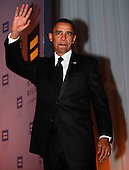 "Washington, DC - October 10, 2009 -- United States President Barack Obama waves as he arrives at the Human Rights Campaign National Dinner in Washington, DC on Saturday, October 10, 2009.  In his remarks, the President restated his campaign pledge to repeal the doctrine of ""don't ask-don't tell"" and allow homosexual men and women to serve openly in the armed forces. Obama also stated his strong support for ending discrimination against bisexuals, gays, lesbians and transgender people..Credit: Yuri Gripas / Pool via CNP"