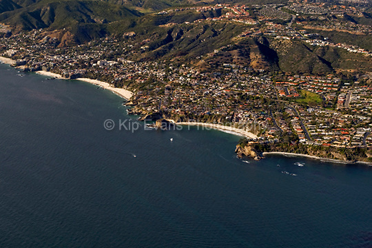 View of Three Arch Bay and Mussel Cove in South Laguna Beach, California, from the air looking north/northeast.