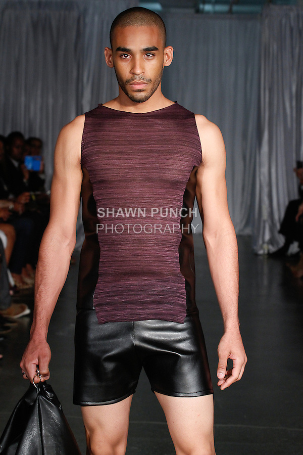 Model walks runway in an outfit from the OMI Spring Summer 2014 collection by Sai One (Angel Rodriguez), during Fashion Week Brooklyn Spring Summer 2014, in Brooklyn, New York on October 4, 2013.