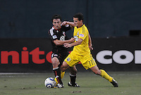 Columbus Crew midfielder Dilly Duka (11) fights for possession of the ball against DC United defender Jed Zayner (12)    The Columbus Crew defeated DC United 1-0 at RFK Stadium, Saturday September 4, 2010.