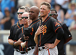 San Francisco Giants hitting coach Barry Bonds and Hunter Pence listen to the National Anthem before a spring training game against the Milwaukee Brewers in Phoenix, AZ, on Thursday, March 23, 2017.<br /> Photo by Cathleen Allison/Nevada Photo Source