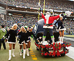 Blitz, the Seattle Seahawks mascot, dressed as Santa  shoots t-shirts into the crowd doing their game against theCleveland Browns at CenturyLink Field in Seattle, Washington on December 20, 2015. The Seahawks clinched their fourth straight playoff berth in four seasons by beating the Browns 30-13.  ©2015. Jim Bryant Photo. All Rights Reserved.