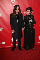 Ozzy Osbourne, Sharon Osbourne<br /> at the 2014 MusiCares Person Of The Year Honoring Carole King, Los Angeles Convention Center, Los Angeles, CA 01-24-14<br /> David Edwards/DailyCeleb.Com 818-249-4998