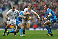 Billy Twelvetrees is tackled in possession. RBS Six Nations match between England and Italy on March 10, 2013 at Twickenham Stadium in London, England. Photo by: Patrick Khachfe / Onside Images