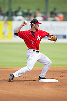 Kannapolis Intimidators second baseman Eddy Alvarez (1) attempts to turn a double play against the Greensboro Grasshoppers at CMC-NorthEast Stadium on September 1, 2014 in Kannapolis, North Carolina.  The Grasshoppers defeated the Intimidators 7-4.  (Brian Westerholt/Four Seam Images)