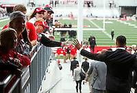 The Ohio State Buckeyes tap hands with fans as they first enter Ohio Stadium to take on Kent State in Columbus, Saturday morning, September 13, 2014. (Dispatch Photo by Jenna Watson)