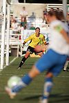01 Aug 2009: Kristine Lilly (foreground) of the Breakers sends a ball into the box as Hope Solo (background) of Saint Louis Athletica readies herself.  Saint Louis Athletica defeated the visiting Boston Breakers 1-0 in a regular season Women's Professional Soccer game at Anheuser-Busch Soccer Park, in Fenton, MO.