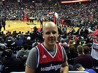 COPY BY TOM BEDFORD MEDIA<br /> Pictured: Matt Evans watching NBA basketball in the USA<br /> Re: Former postman, lotto Millionaire Matt Evans, 35, from Barry, south Wales, who has been spending his winnings to travel the world to watch various sports events.