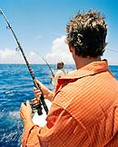 USA, Florida, men fishing on boat in the Atlantic, Islamorada