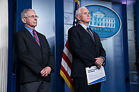 Director of the National Institute of Allergy and Infectious Diseases at the National Institutes of Health Dr. Anthony Fauci and United States Vice President Mike Pence listen as US President Donald J. Trump delivers remarks on the COVID-19 (Coronavirus) pandemic alongside members of the Coronavirus Task Force in the Brady Press Briefing Room at the White House in Washington, DC, March 25, 2020, in Washington, D.C. <br /> Credit: Sarah Silbiger / Pool via CNP/AdMedia