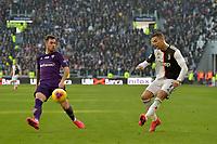2nd February 2020; Allianz Stadium, Turin, Italy; Serie A Football, Juventus versus Fiorentina; Cristiano Ronaldo of Juventus crosses the ball in the box as Pol Lirola of Fiorentina closes