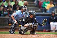 Umpire Blake Felix and New Britain Rock Cats catcher Tom Murphy (9) during a game against the Akron RubberDucks on May 21, 2015 at Canal Park in Akron, Ohio.  Akron defeated New Britain 4-2.  (Mike Janes/Four Seam Images)