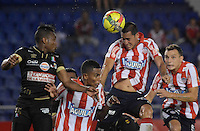 BARRANQUIILLA -COLOMBIA-02-11-2014. William Tesillo (C Izq) Breyner Garcia Renteria (C Der) y Andres Correa (Der) jugadores de Atlético Junior disputan el balón con Luis Carlos Murillo (Izq) jugador de Once Caldas durante partido por la fecha 17 de la Liga Postobón II 2014 jugado en el estadio Metropolitano Roberto Meléndez de la ciudad de Barranquilla./ William Tesillo (C L) Breyner Garcia Renteria (C R) y Andres Correa (R) player Atletico Junior fights for the ball with Luis Carlos Murillo (L) player of Once Caldas during match for the 17th date of the Postobon League II 2014 played at Metropolitano Roberto Melendez stadium in Barranquilla city.  Photo: VizzorImage/Alfonso Cervantes/STR