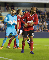 David McGoldrick of Ipswich Town laughs as a fan shouts abuse during the Sky Bet Championship match between Millwall and Ipswich Town at The Den, London, England on 15 August 2017. Photo by Alan  Stanford / PRiME Media Images.